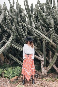 boho chic outfit with black hat and flowery skirt