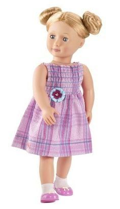 """Our Generation Sadie Non Poseable 18"""" Doll by Maison Joseph Battat Ltd.. $44.68. Outfits interchangeable with most 18"""" dolls. Sadie. Eyes open and close. Our Generation 18"""" Non-Poseable Doll. Your little girl can have her own pretend daughter or little friend thanks to an Our Generation doll. Sadie comes dressed for a day of fun in a plaid dress with cute sunflower detail, plus matching pink shoes and white socks. The doll has an adorable hairstyle with 2 buns.  It comes with ..."""