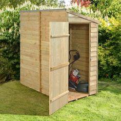 cabane de jardin en bois et rangement à l'extérieur