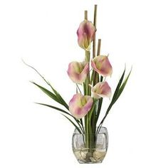 """Faux pink calla lily arrangement in a glass vase.     Product: Faux floral arrangement    Construction Material: Silk    Color: Pink  Features:  Five calla lillies and bamboo supports    Artificial water and river rock in square glass vase  Dimensions: 18"""" H x 8"""" Diameter"""