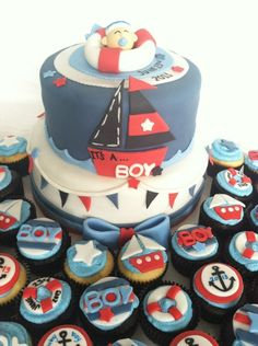 Sailor themed baby shower cake and cupcakes.