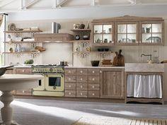 Mediterrane Kücheneinrichtung - Küchenschränke mit attraktiver Holzmaserung