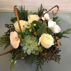 This Texture Box floral arrangement did double duty; it was sent to celebrate both Hanukkah and to wish a Merry Christmas. Polo roses, phalaenopsis orchid blooms, succulents, privet berries, succulents, white gomphrena, princess pine, cedar, fasciated willow branches and wire balls in a wooden box.