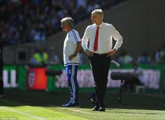 Arsenal manager Arsene Wenger (right) has finally beaten his fierce rival Jose Mourinho (l...