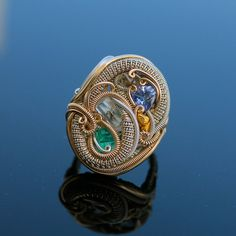 This unique ring features a Garnet Cabochon The stone is bezel set