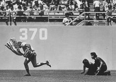 One of the greatest moments in baseball history, Rick Monday saves the American flag from being burned by two protesters; April 25, 1976