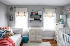 Paint, Quiet Nursery Mist and Sprinkle.  Bird Mobile - Etsy. Birdcages and Pillows: Homegoods.  Book shelves - IKEA or target. Animal Hooks: anthropologie.