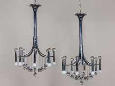 This Pair Of Elegant Chromed Metal Italian Chandeliers Embos The Talents Gaetano Sciolari Scion Famous Lighting Company Who Took Their