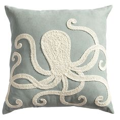 Grab onto Pier 1's elaborately embroidered octopus on a blue background to complement an ocean-themed room.