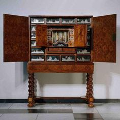unit is a cabinet of curiosities like the one above in Amsterdam's Rijksmuseum, probably made in the Northern Netherlands between 1675 and 1700.