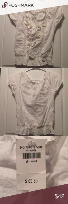 Abercrombie Girls' Floral Peplum Top This white peplum top has cute floral details. abercrombie kids Shirts & Tops Button Down Shirts