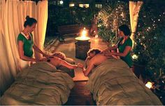 Fireside Massage for 2 includes appetizers cuddled up next to fire.