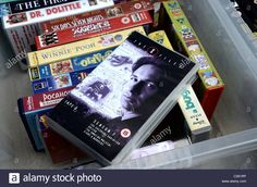 Download this stock image: Video Tapes for sale outside a charity shop in Edinburgh, including a copy of the X-Files season 7. - C261RP from Alamy's library of millions of high resolution stock photos, illustrations and vectors.