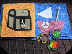 a treasure chest complete with lock and key. Wouldn't it be fun to put fruit snacks in the pocket so that he has to open the chest to get the treat? This page also has a fishing game. The fish and pole are magnets and they all store in the boat pocket.
