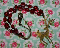 Handmade Antique Bronze Beaded Necklace With Stag by PlasticFloozy, £4.99
