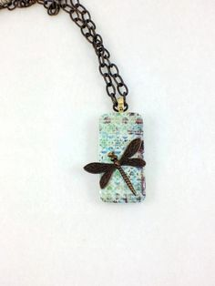 Stunning and a little edgy brass dragonfly domino pendant hanging from a brass etched chain $28.00