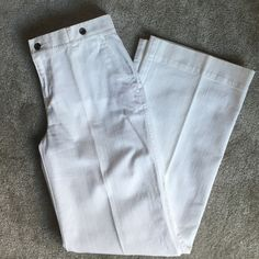 Ralph Lauren white wide leg jeans This is a pair of Lauren by Ralph Lauren jeans. They are wide leg with some button details around the waist. There is some slight discoloration by some of the belt loops, but the rest of the jeans are in tip top shape! Lauren Ralph Lauren Jeans Flare & Wide Leg