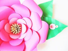 Looking for a fun and easy DIY to make giant paper flower for decorating? Learn how to make large paper flowers. Easy DIY flower tutorial.