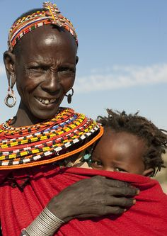 https://flic.kr/p/9RbShm | Samburu mother and baby - Kenya |  The Samburu is closely related to the Maasai.  Like the Maasai, they live in the central Rift Valley area of Kenya, where the climate is semi-arid. They are seminomadic and belong to the Maa (Nilotic) speaking group of people. They do very little farming. Their livelihood depends upon the cattle, sheep and goats they raise. They use their milk more than meat. They often drink milk mixed with cow's blood. So, like their…