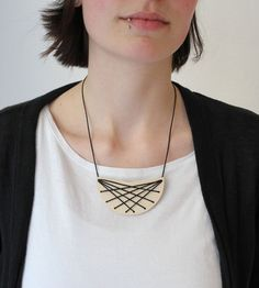 punched plywood necklace