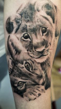 Lion cub tattoo. #blackandgrey #realism #lioncub #childrentattoo #tributetattoo