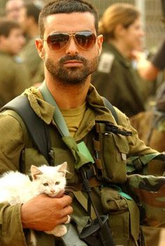 IDF soldier rescues injured kitten from across border.   The sexiness doesn't stop.