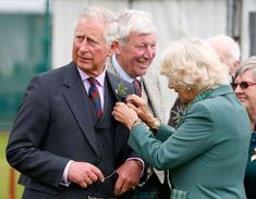 "Express Pictures on Twitter: ""Camilla pins a sprig of heather and thistle onto the lapel of Prince Charles"