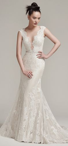 "Effortless glamour! Sottero and Midgley ""Wyatt"" is a stunning modern lace sheath wedding dress that flaunts a sexy, plunging illusion neckline and lace cap-sleeves.    #bridal #wedding #weddingdress #weddinggown #bridalgown #dreamgown #dreamdress #engaged #inspiration #bridalinspiration #bride #weddinginspiration #weddingdresses #romantic #sotteroandmidgley #midgleybride #lace"