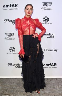 Red hot: Olivia Culpo donned a sheer red lace blouse when she stepped out for the amfAR generationCURE Solstice 2017 in New York City on Tuesday