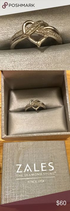 Heart Ring/Promise Ring from Zales New in Box New never used - Size 7 - heart ring/promise ring - originally purchased for $99 - brand New in box top of box has a small water spot. Zales Jewelry Rings