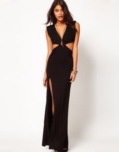 Perfect statement for holiday parties-This maxi dress by Love has been crafted from soft, stretch jersey. The details include: a plunging neckline, a twist front detail with cut-out sides and a thigh split to one side. The dress has been cut with a regular fit. Sizes S-L (fits size 2-10). Availab...