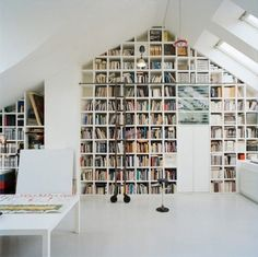 Loft by Carouschka Streijffert // conversion of attic space into a loft in Stockholm If only I lived in a house that had a roof attic. All those booooks. Lofts, Attic Spaces, Attic Rooms, Library Wall, Attic Library, My Ideal Home, Attic Conversion, Attic Remodel, Attic Renovation