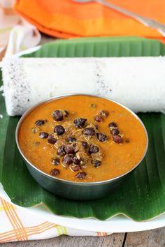 Kadala curry - coconut based black chickpeas curry served with Puttu (Kerala breakfast dish)