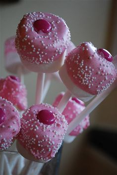 """I just placed a large marshmallow on the end of a sucker stick and then dipped half the marshmallow into melted chocolate.  I just added some pink food coloring into white chocolate melts but you can also purchase pink ones.  I added some white sprinkles and a pink M & M on the top (thank goodness for Breast Cancer Awareness M & M's)"""