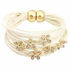 """Layered magnetic string bracelet in ivory with flower charms.  Product: BraceletConstruction Material: Nickel-free metal alloy and magnetic stringColor: Ivory and goldFeatures:  Magnetic claspFlower charm Dimensions: 1"""" H x 2.5"""" DiameterCleaning and Care: Wipe clean with dry cloth"""