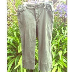 Olive capris! Cute capris w/ cute buttons on the bottom cuffs.Capris are in great condition,and gently used. First issue Pants Capris
