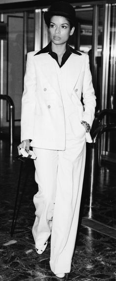 Bianca Jagger rocked her white wide-leg pants with a matching double-breasted blazer for a winning outfit. Skip the wide collar shirt and bowler hat for a plunging camisole and loose waves. You're ready to hit the town.