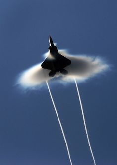 totally cool visible evidence of what the sound barrier looks like when a military plane breaks it.