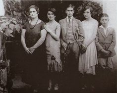 Frida Kahlo in drag in the middle. WOW.