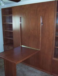 Fold-down Table with Murphy bed and book case.