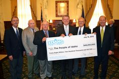"""For the tenth consecutive year, the Idaho Lottery has returned a record breaking dividend to the people of Idaho. Today's announcement came during a ceremony with Governor C. L. """"Butch"""" Otter as the Idaho Lottery Commission presented him with a check for $48,200,000 – the largest dividend in the 24 year history of the Lottery."""