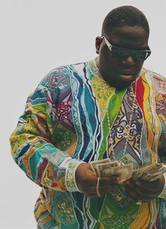 Biggie. I have this image on a t-shirt. Definitely one of my favourite rappers. Hip-hop now differs so much from the 80s/90s and I don't really like it.