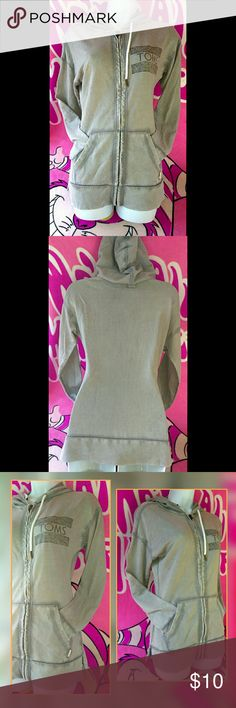 Toms Gray Hoodie Size xs Never used.  Just been hanging in my daughter's closet.  Has some very light wear. Toms Sweaters