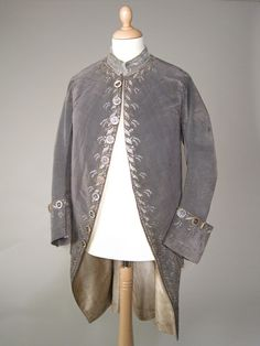 Court coat, France, 1770-1780. Mauve-grey uncut velvet, embroidered with leaves and sprays in metal thread, silk and metal and glass spangles, lined cream twilled silk.