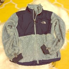 North Face Osito Jacket Denali Summit Series, Fuzzy soft light blue and navy blue. So comfortable. Has a small hole in sleeve, not noticeable at all because of the the material. Size small. North Face Jackets & Coats