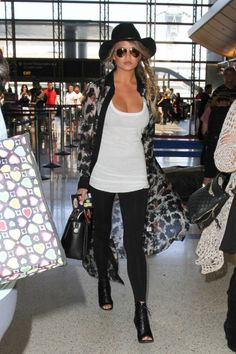 15 cute leggings outfit ideas to try this fall without looking frumpy: Chrissy Teigen dresses up her leggings and tank top by adding a sheer duster jacket, wide-brim hat and heeled booties