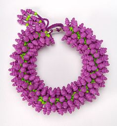 Lovely fuchsia choker necklace by Felicity Peters. Inspired by the Gherkin Stg silver earplugs thread.  2nd Prize Contemporary Wearables 2007. Collection Toowoomba Regional Gallery QLD 2007.  Large necklace, statement necklace