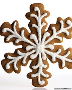 Gingerbread Snowflakes This seven-inch flake, prettier than a gingerbread house or a gingerbread man, is big enough to share -- but who really wants to? Sanding sugar atop piped royal icing gives it an icy sheen. YIELD:Makes 16 cookies Noel Christmas, Christmas Goodies, Christmas Treats, Christmas Baking, Xmas, Christmas Decor, Christmas Design, Christmas Desserts, Shaped Cookies Recipe