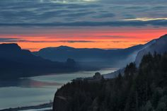 Sunrise Over Crown Point - Sunrise Over Vista House on Crown Point at Columbia River Gorge from Portland Women's Forum State Park Viewpoint in Oregon.