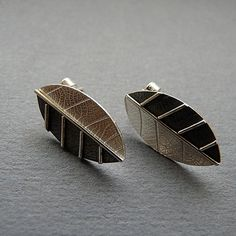 These contemporary leaf studs are entirely hand made in sterling silver . They have been textured, imprinted, partially oxidized and polished to a  1cm wide 2cm long.  $76